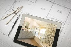 Computer Tablet with Master Bathroom Design Over House Plans. Pencil and Compass stock photo