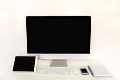 Computer tablet and mobile phone with blank black screen Stock Photos