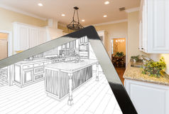 Computer Tablet Showing Drawing of Kitchen Photograph Behind Royalty Free Stock Photos