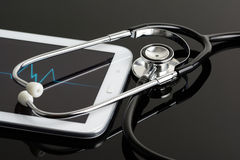 Computer tablet and stethoscope Stock Image