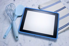 Computer-Tablette, die Hintergrund kocht Stockfotos