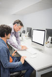 Computer teacher assisting a student Royalty Free Stock Photo