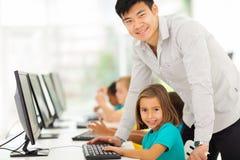Computer teacher students. Portrait of elementary school computer teacher and students in computer room Stock Images