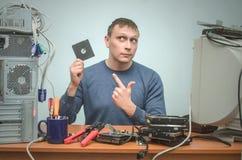 Computer repairman. Computer technician engineer. Support service. stock photo