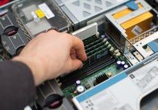 Computer technician installing RAM. Stock Image
