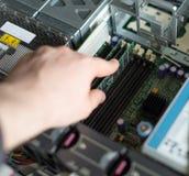Computer technician installing RAM memory. Royalty Free Stock Image