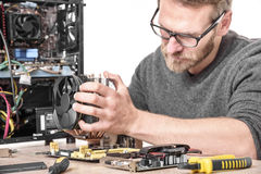 Computer technician installs cooling system Royalty Free Stock Photography