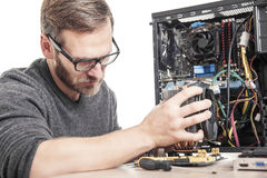 Computer technician installs cooling system. Stock Photography