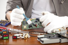 Computer technician. Male hand of computer technician cleaning parts Stock Photos