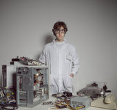 Computer technician. Portrait of a Computer technician with a computer destroyed Stock Photo