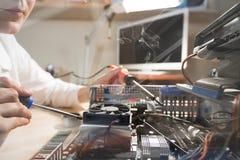 Computer Technician repairing Hardware throw the window image Stock Image