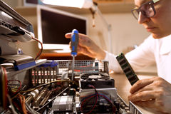 Computer Technician repairing Hardware with tools Royalty Free Stock Images