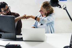 Computer technicians friends hit fists together stock photo