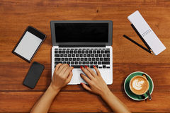Computer Technology. Freelancer Woman Typing, Working At Cafe. Computer Technology. Top View Of Female Hands Typing On Notebook Keyboard. Freelancer Woman stock photo