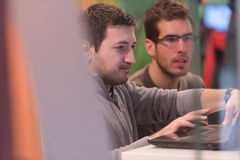 Computer technology students. Young computer technology students on code programming class have presentation royalty free stock photo