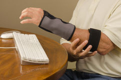 Computer Tendinitis Carpal Tunnel Syndrome Repetitive Stress. A man is experiencing computer user pain with tendinitis, carpal tunnel syndrome and repetitive Stock Photography
