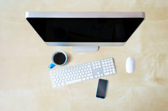 Computer texture tree table background, keyboard, mouse, blue mug and phone Stock Photos