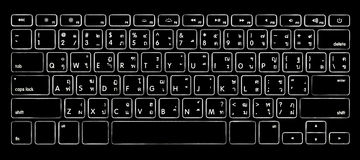 Computer thai alphabet keyboard with backlight. Computer thai alphabet keyboard with illuminated backlight Royalty Free Stock Images