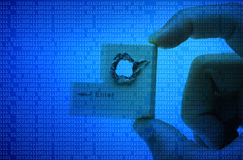Computer threat. Hacker's hand picking up computer enter button with a hole representing computer security breach isolated Stock Photos