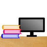 Computer and three books on a table Royalty Free Stock Images