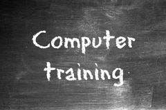 Computer training. Written on a worn blackboard Royalty Free Stock Images