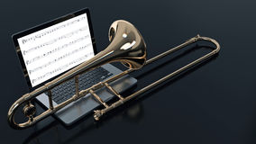 Computer with trombone Royalty Free Stock Photography