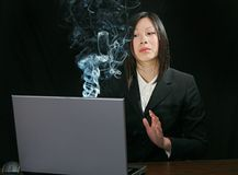 Computer trouble for asian girl. Young attractive asian woman working on a laptop computer Stock Images