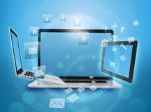 Computer und Tablette mit drehenden Ikonen herum Lizenzfreie Stockfotos