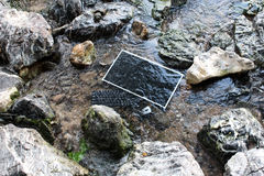 The computer under the surface of the water in a waterfall. Royalty Free Stock Photo