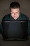 Computer user in darkened room Stock Photography