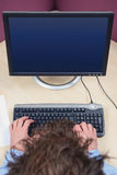 Computer user overhead blank screen Stock Photo
