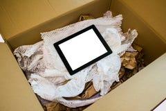 Computer van de Unboxings de nieuwe tablet Stock Foto's