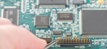 Computer Video Card Repair. On a White Background Royalty Free Stock Photo