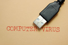 Computer virus. Concept with a USB cable Stock Photography