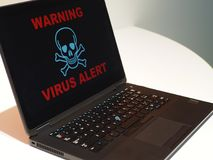 Computer Virus Alert concept. Warning on laptop. royalty free stock images