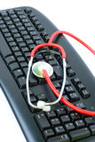 Computer virus concept. With keyboard and stethoscope Stock Photography