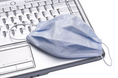 Computer Virus Concept Image. With Surgical Mask and Laptop Computer Stock Photos