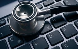 Computer virus concept image. Stethoscope lying on keyboard. Stethoscope lying on a laptop keyboard. Computer virus concept image Royalty Free Stock Photo