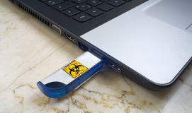 Computer Virus. Infecting a laptop with a Computer Virus via usb stick, free copy space Stock Photos