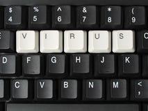 Computer virus. Computer keyboard with keys forming virus word Royalty Free Stock Photography
