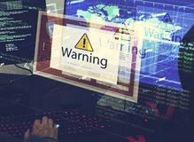 Computer with warning pop up sign window. And blur image Royalty Free Stock Photo