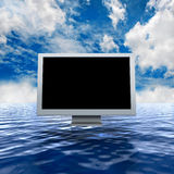 Computer on the water to a nice sky background Stock Image