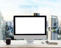Computer white frame on work table in office place city. Desktop computer white frame on work table in office place city background Stock Photo