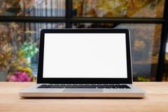 Computer with white screen on table with blur background. Techno. Logy concept royalty free stock photos