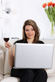 Computer and wine Royalty Free Stock Image