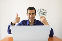 Computer and winning many us dollar Royalty Free Stock Photos