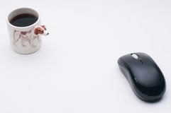 Computer wireless mouse, cup of coffee, Jack Russel dog side of coffee cup Royalty Free Stock Images
