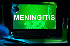 Computer with words Meningitis. Stock Images
