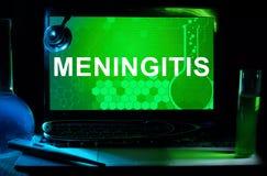 Computer with words Meningitis. Stock Images