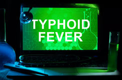 Computer with words Typhoid Fever. Royalty Free Stock Photo